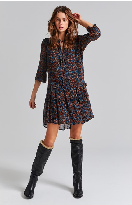 Woman wearing a dress and boots